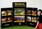 Portable Velcro, three panel tabletop presentation board for Gold's Gym